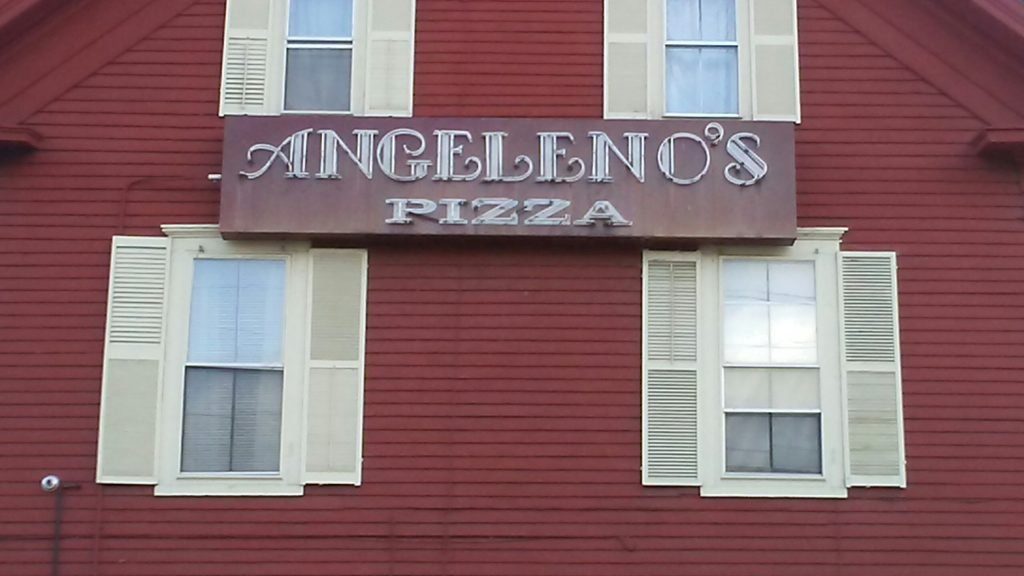 Rotted wooden sign removed/replaced from the front of a restaurant.