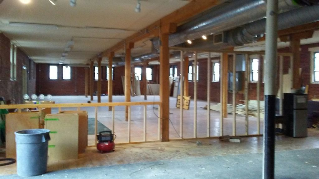 A building's interior with wood framing by Protech