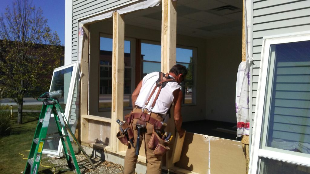 A contractor from Protech replacing a window in Northern Vermont.